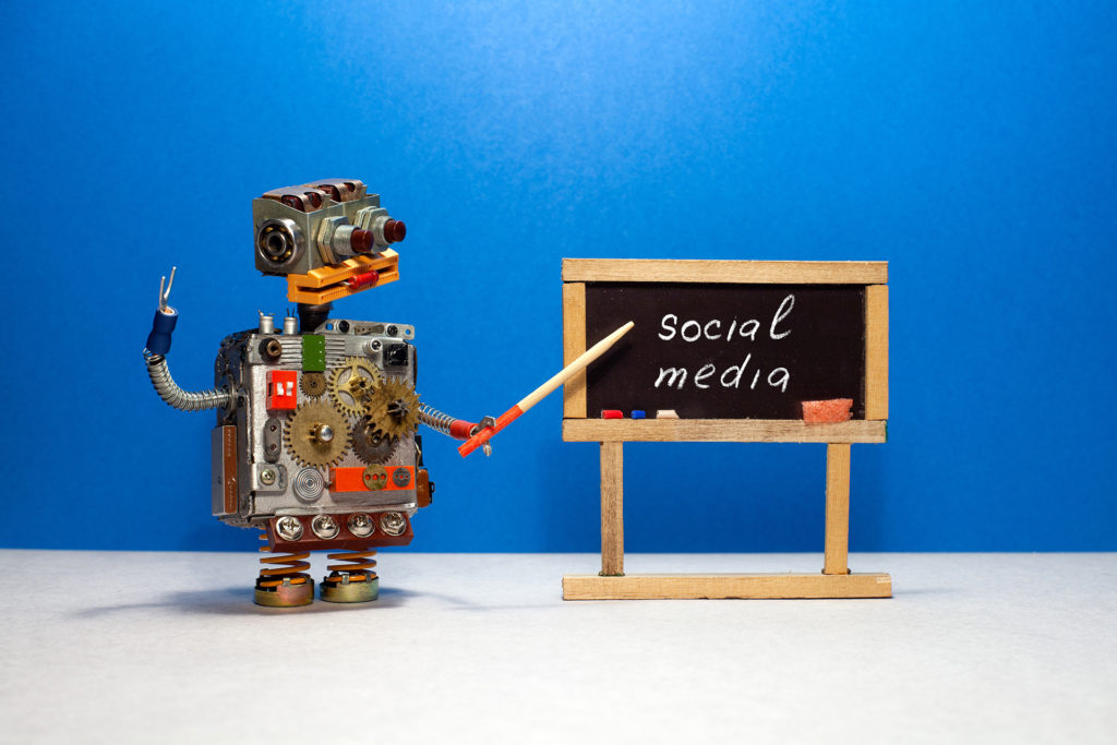 Social Media Concept With Robot At Blackboard