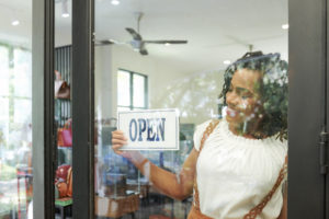 Woman Opening Store For Business